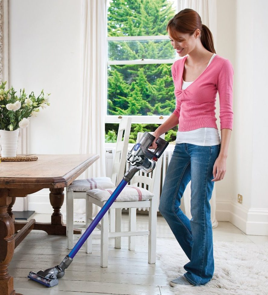 woman-cleaning-floor-with-vacuum